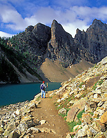 Hiker on path around Agnes Lake. Banff National Park, Canada