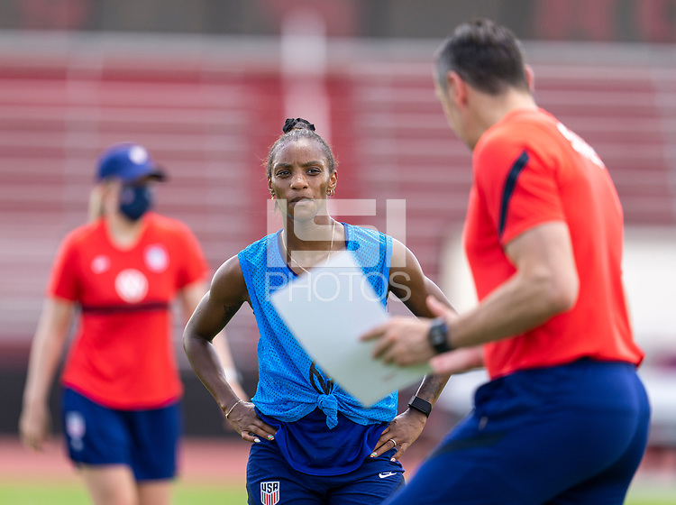 HOUSTON, TX - JUNE 8: Crystal Dunn #19 of the USWNT listens to Vlatko Andonovski during a training session at the University of Houston on June 8, 2021 in Houston, Texas.