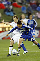Ryan Pore of the Kansas City Wizards and Bryan Namoff of D.C. Unitedtd. The Kansas City Wizards defeated D. C. United 2 - 0 during a Major League Soccer match at CommunityAmerica Ballpark in Kansas City, Kansas on March 29, 2008.