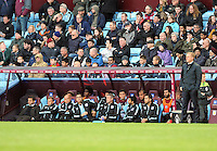 Manager Tim Sherwood of Aston Villa looks dejected slumped in his chair as his side lose at home 1-2 after going ahead against Manager Garry Monk of Swansea City's side during the Barclays Premier League match between Aston Villa v Swansea City played at the Villa Park Stadium, Birmingham on October 24th 2015