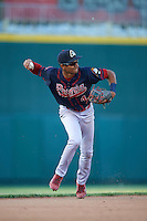 Peoria Chiefs shortstop Oscar Mercado (4) throws to first after making a play during a game against the Lansing Lugnuts on June 6, 2015 at Cooley Law School Stadium in Lansing, Michigan.  Lansing defeated Peoria 6-2.  (Mike Janes/Four Seam Images)