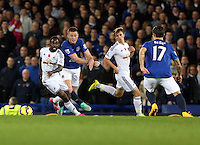 Liverpool, UK. Saturday 01 November 2014<br /> Pictured: Nathan Dyer of Swansea (L) challenged by James McCarthy of Everton (2nd L)<br /> Re: Premier League Everton v Swansea City FC at Goodison Park, Liverpool, Merseyside, UK.