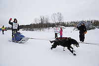 Ben Harper and dog team leaves the start line of the 2013 Junior Iditarod on Knik Lake.  Knik Alaska..Photo by Jeff Schultz/IditarodPhotos.com   Reproduction prohibited without written permission