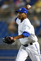 Dunedin Blue Jays pitcher Alberto Tirado (46) chases a runner back to third in a rundown during a game against the Clearwater Threshers on April 10, 2015 at Florida Auto Exchange Stadium in Dunedin, Florida.  Clearwater defeated Dunedin 2-0.  (Mike Janes/Four Seam Images)