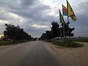 Syria 2019  At the entrance of a city in Rojava, flags of YPG, The People's Defense Unit<br /> Syrie 2019 A l'entrée d'une ville du Rojava, les drapeaux de YPG, Unité de Protection du Peuple