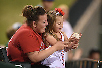 Peoria Chiefs young fan gets a foul ball during a game against the Kane County Cougars on June 2, 2014 at Dozer Park in Peoria, Illinois.  Peoria defeated Kane County 5-3.  (Mike Janes/Four Seam Images)