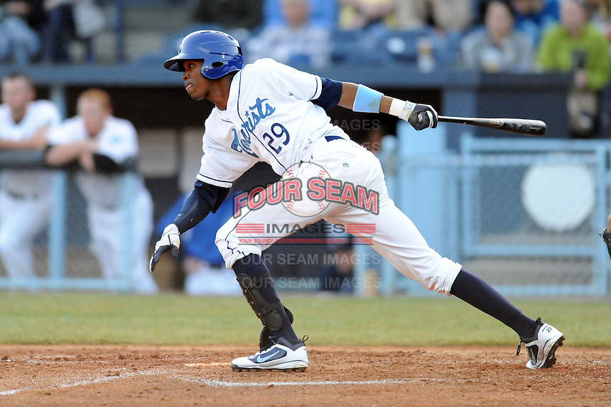 Asheville Tourists third baseman Rosell Herrera #29 swings at a pitch during a game between the West Virginia Power and the Asheville Tourists at McCormick Field, Asheville, North Carolina April 9, 2012. The Tourists won 13-5  8-4  (Tony Farlow/Four Seam Images)..