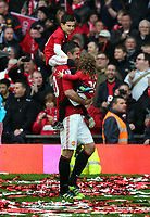 Pictured: Robin van Persie with his two young children. Sunday 12 May 2013<br /> Re: Barclay's Premier League, Manchester City FC v Swansea City FC at the Old Trafford Stadium, Manchester.