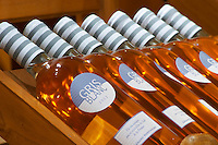 Gris Blanc rose wine 2005 called Gris Blanc (grey white) on display. Domaine Gerard Bertrand, Chateau l'Hospitalet. La Clape. Languedoc. The wine shop and tasting room. France. Europe. Bottle.