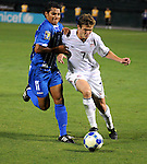 08 July 09: RObbie Rogers, 7, (US) and Mariano Acevedo, 11 (HON) fight for the ball during their match at the CONCACAF Gold Cup at RFK Stadium in Washington, DC.