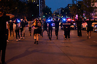 Demonstrators cheer as police disperse during a protest in Washington, D.C., U.S., on Monday, June 1, 2020, following the death of an unarmed black man at the hands of Minnesota police on May 25, 2020.  More than 200 active duty military police were deployed to Washington D.C. following three days of protests.  Credit: Stefani Reynolds / CNP/AdMedia