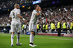 Real Madrid's Chicharito cerebrates a goal (1-0) with Pepe during quarterfinal second leg Champions League soccer match against Atletico de Madrid at Santiago Bernabeu stadium in Madrid, Spain. April 22, 2015. (ALTERPHOTOS/Victor Blanco)