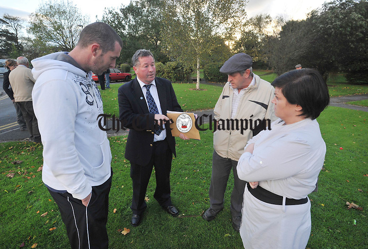 Councillor Michael Guilfoyle chats with Cloughleigh residents, Sean Kelleher, Tony Mc Carthy and Pamela Kelleher outside the meeting to discuss the proposed development of a youth centre in the area. photograph by Declan Monaghan