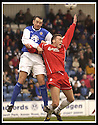 01/03/2003                   Copyright Pic : James Stewart.File Name : stewart-qots v falkirk 02.DEREK ANDERSON PULLS AT LEE MILLER.....James Stewart Photo Agency, 19 Carronlea Drive, Falkirk. FK2 8DN      Vat Reg No. 607 6932 25.Office     : +44 (0)1324 570906     .Mobile  : +44 (0)7721 416997.Fax         :  +44 (0)1324 570906.E-mail  :  jim@jspa.co.uk.If you require further information then contact Jim Stewart on any of the numbers above.........