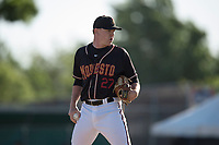 Modesto Nuts relief pitcher Jack Anderson (27) looks to his catcher for the sign during a California League game against the San Jose Giants at John Thurman Field on May 9, 2018 in Modesto, California. San Jose defeated Modesto 9-5. (Zachary Lucy/Four Seam Images)