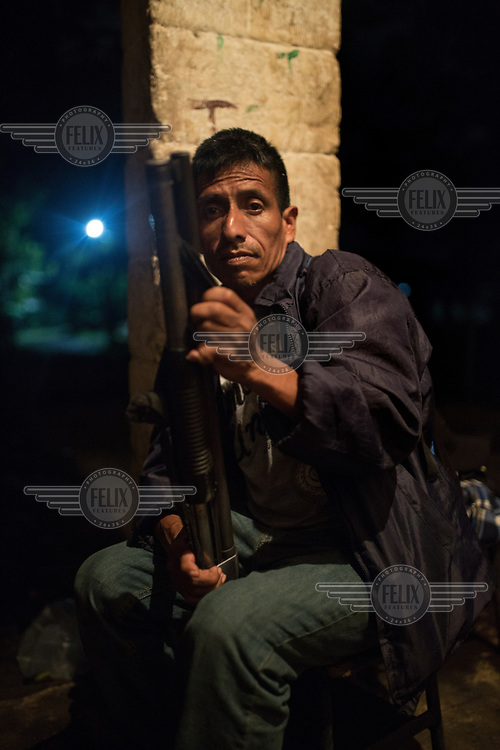 Celestino Montejo, 43, member of the community security committee of La Trinidad, takes a break from doing security rounds in the main outpost. While most of the 235 families remain in shelters after the 3 June 2018 eruption of the Fuego volcano, Juan Francisco and 11 other men, members of the community's security committee, remain in La Trinidad to guard the homes and belongings. Originally from Huehuetenango, hundreds of families fled to Mexico in 1982 escaping state-repression during the war. In 1998, after the peace accords, the families were given land at the foot of the Fuego Volcano as part of an agreement for returning refugees. Today, La Trinidad is one of the most affected communities due to the 3 June 2018 eruption. Their community has been deemed uninhabitable and the 235 families await an uncertain future once again.