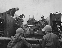 BNPS.co.uk (01202) 558833. <br /> Pic: Bosleys/BNPS<br /> <br /> Pictured: SAS troops loading a jeep onto a barge to cross the Rhine, Germany. <br /> <br /> Never before seen photos taken by a fishmonger turned SAS hero behind enemy lines in World War Two have come to light 76 years on.<br /> <br /> Sergeant Samuel Rushworth, of the 2nd Special Air Service, was dropped into occupied France two days before D-Day in June 1944.<br /> <br /> They were tasked with disrupting German reinforcements dispatched to Normandy following the Allied landings.