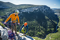 Two climbers at the top of the climb, Verdon Gorge, France