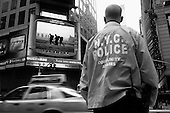 New York, New York.USA.March 21, 2003..The jumbo television screens and electronic signs in Time Square keep New Yorkers up-dated on the events in Iraq.