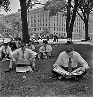 Government workers lunching and resting in Washington Monument park outside the U.S. Department of Agriculture. Washington, D.C. July 1942.<br /> <br /> Photo by Marjory Collins.