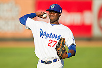 Bladimir Franco (27) of the Ogden Raptors warms up in the outfield prior to the game against the prior to the game against the \iz\ at Lindquist Field on July 28, 2012 in Ogden, Utah.  The Raptors defeated the Owlz 8-7.   (Brian Westerholt/Four Seam Images)
