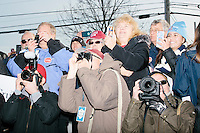 From left, photographers Nate Gowdy, Jon Hill, and Brian Snyder, take pictures as Texas senator and Republican presidential candidate Ted Cruz speaks at a Second Amendment Rally outside Granite State Indoor Range in Hudson, New Hampshire.