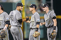 Vanderbilt Commodores first baseman Zander Wiel (43) congratulates teammates Tyler Campbell (2) and Will Toffey (10) after the NCAA College baseball World Series against the TCU Horned Frogs on June 16, 2015 at TD Ameritrade Park in Omaha, Nebraska. Vanderbilt defeated TCU 1-0. (Andrew Woolley/Four Seam Images)