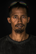 32 year old Tuna fisherman, Alejandro Dalang poses for a portrait at the Casa, the Tuna buying house in Puerto Princesa, Palawan in the Philippines. <br /> Photo: Sanjit Das/Panos for Greenpeace