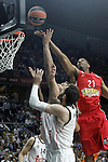 Real Madrid's Felipe Reyes (l) and Rudy Fernandez (d) and Olympiacos Piraeus' Tremmell Darden during Euroleague Final Match. May 15,2015. (ALTERPHOTOS/Acero)