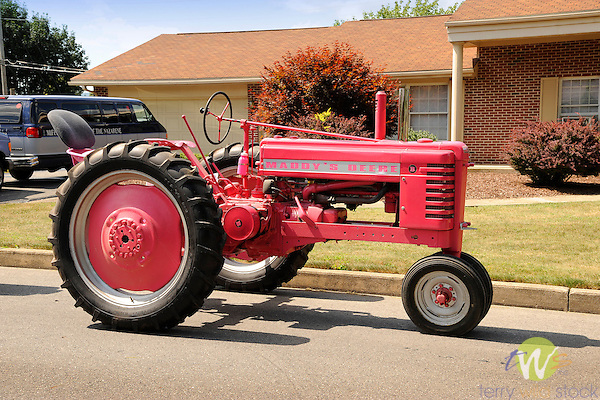 1940's John Deere B tractor painted pink for Breast Cancer Association.