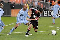 D.C. United forward Hamid Salihi (9) goes against Sporting Kansas City defender Aurelien Collin (78) Sporting Kansas City defeated D.C. United  1-0 at RFK Stadium, Saturday March 10, 2012.