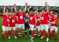 Calum Best & Luther Blissett celebrate with teammates and the trophy during the Sellebrity Soccer - Celebrity & legends football match with profits going to Watford Community sports & education trust at Vicarage Road, Watford, England on 12 May 2018. Photo by PRiME Media Images.