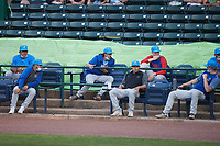 Members of the Myrtle Beach Pelicans pitching staff sit socially distanced in the stands during the game against the Lynchburg Hillcats at Bank of the James Stadium on May 22, 2021 in Lynchburg, Virginia. (Brian Westerholt/Four Seam Images)