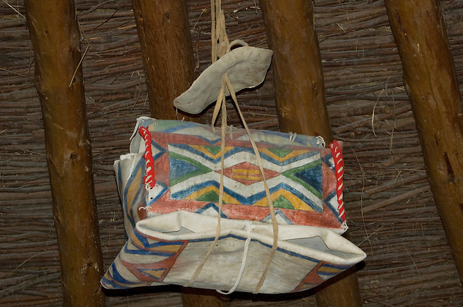 Painted Mandan storage box made from rawhide parfleche on display inside a earthen lodge at the Knife River Indian Village, North Dakota