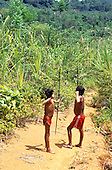 Roraima, Brazil. Two Yanomami teenage boys practising with bows and arrows.