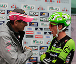 Dan Martin (IRL) Cannondale-Garmin talks to Matt Rendal about his shoulder injury at sign on for the start of the 2015 96th Milan-Turin 186km race starting at San Giuliano Milanese, Italy. 1st October 2015.<br /> Picture: Eoin Clarke | Newsfile