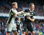 Queens keeper Robbie Thomson celebrates with captain Chris Higgins after saving Waghorn's penalty kick. Waghorn will pop up and haunt them by scoring the winner in just over a minute.