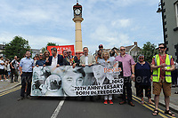"The NHS rally reaches the town clock during ""The Bevan Festival"" celebrating the 70th Anniversary of the National Health Service. <br /> <br /> Tredegar, South Wales, Sunday 1st July 2018 <br /> <br /> <br /> Jeff Thomas Photography -  www.jaypics.photoshelter.com - <br /> e-mail swansea1001@hotmail.co.uk -<br /> Mob: 07837 386244 -"
