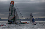 Groupama and Gitana XI at the start Route du Rhum La Banque Postale 2010..The Route du Rhum is a transatlantic single-handed yacht race, which takes places every 4 years in November. The course is between Saint Malo, Brittany, France and Pointe-à-Pitre, Guadeloupe.