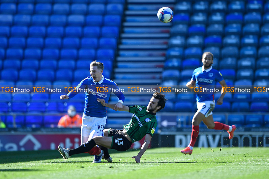 Jimmy Keohane of Rochdale right fouls Ronan Curtis of Portsmouth with a crunching tackle during Portsmouth vs Rochdale, Sky Bet EFL League 1 Football at Fratton Park on 2nd April 2021
