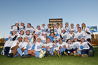 The North Carolina Tar Heels players pose with the championship trophy after the game. The North Carolina Tar Heels defeated the Notre Dame Fighting Irish 2-1 during the finals of the NCAA Women's College Cup at Wakemed Soccer Park in Cary, NC, on December 7, 2008. Photo by Howard C. Smith/isiphotos.com