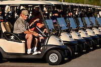 A golfer sits in his cart as he waits to start his round in Charleston, SC.