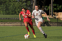 NEWTON, MA - AUGUST 29: Riley Lochhead #21 of Boston College brings the ball forward as Jenna Oldham of Boston University closes during a game between Boston University and Boston College at Newton Campus Field on August 29, 2019 in Newton, Massachusetts.