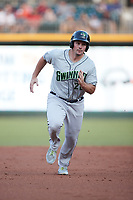 Travis Snider (26) of the Gwinnett Stripers hustles towards third base against the Charlotte Knights at Truist Field on July 17, 2021 in Charlotte, North Carolina. (Brian Westerholt/Four Seam Images)