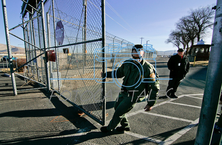 A correctional officer closes the main gate after a van containing the last handful of inmates pulled out of the historic Nevada State Prison, in Carson City, Nev.,on Monday, Jan. 9, 2012. The 150-year-old facility has been closed by state budget cuts..Photo by Cathleen Allison