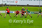 Ballyheugue's Colin Walsh breaks from the tackle of Jack Brosnan of Lixnaw in the encounter in R2 of the County Senior Hurling championship