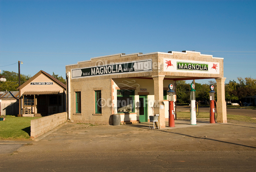 Restored Magnolia (Mobile) Oil service station downtown Shamrock, Texas with glass bowl pumps