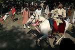 A horse owner rides his horse during a horse show at Sonepur fair ground. Bihar, India, Arindam Mukherjee