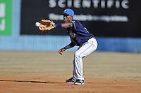 Asheville Tourists second baseman Juan Ciriaco #2 fields and throws to first during the completion of a rain shortened game against the West Virginia Power at McCormick Field on April 12, 2013 in Asheville, North Carolina. The Power won the game 11-4. (Tony Farlow/Four Seam Images).