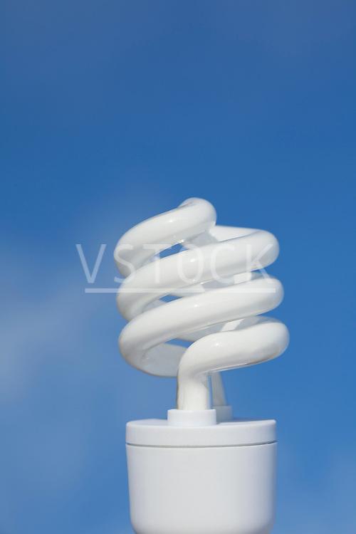 Energy efficient light bulb on blue background